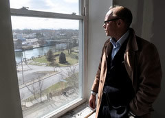 Joachim Ohlin, director of hospitality of the Hotel Clarence, in Seneca Falls, looks out one of the fourth floor rooms overlooking downtown. The hotel is scheduled to open in June.